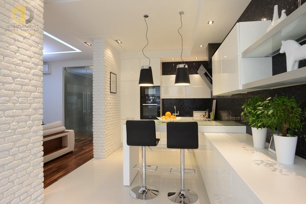 Белая кирпичная кладка в отделке минималистичной кухни