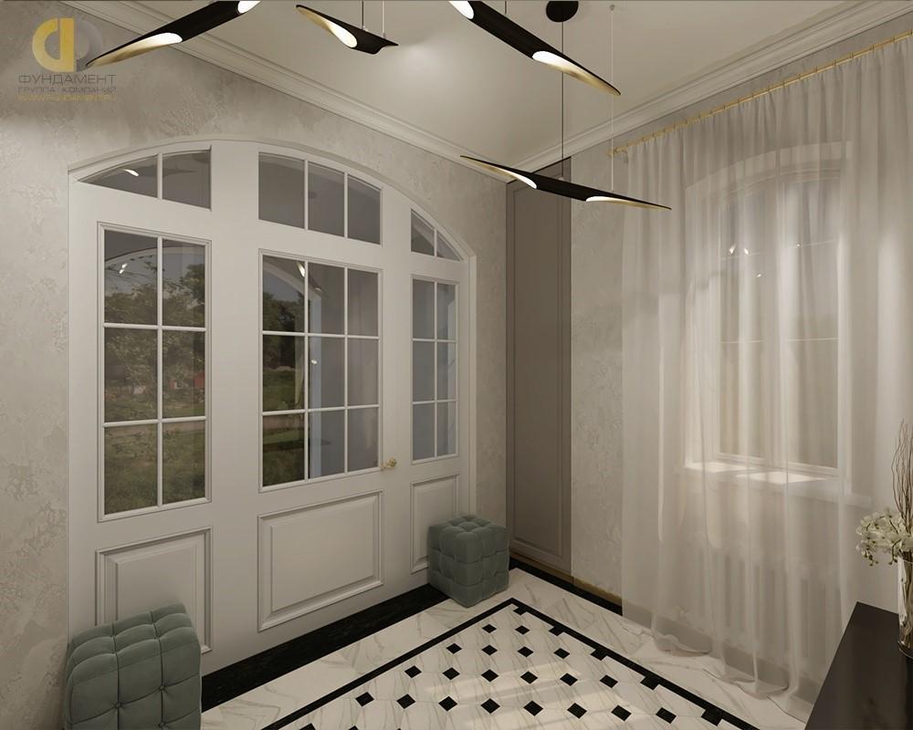 Интерьер прихожей с большой красивой дверью