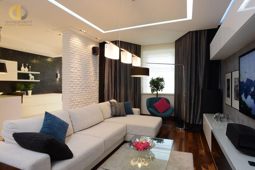 На фото: Интерьер гостиной в квартире в стиле лофт
