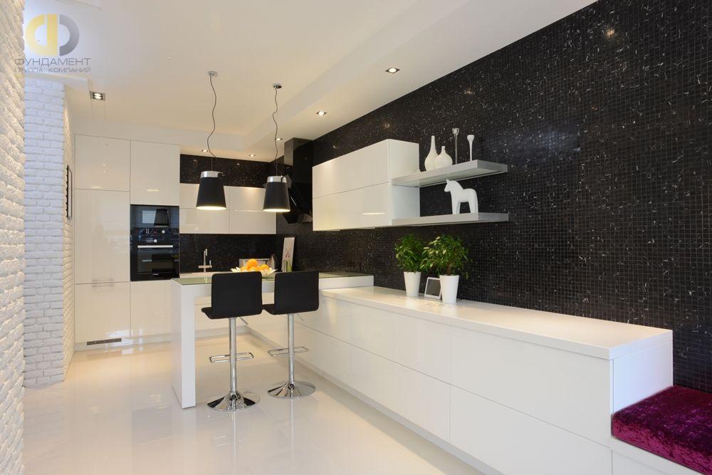 На фото: Интерьер кухни в квартире в стиле лофт